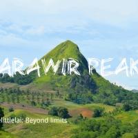 The unassuming comeliness of the MARAWIR PEAK as it's selfishly standing in a valley.